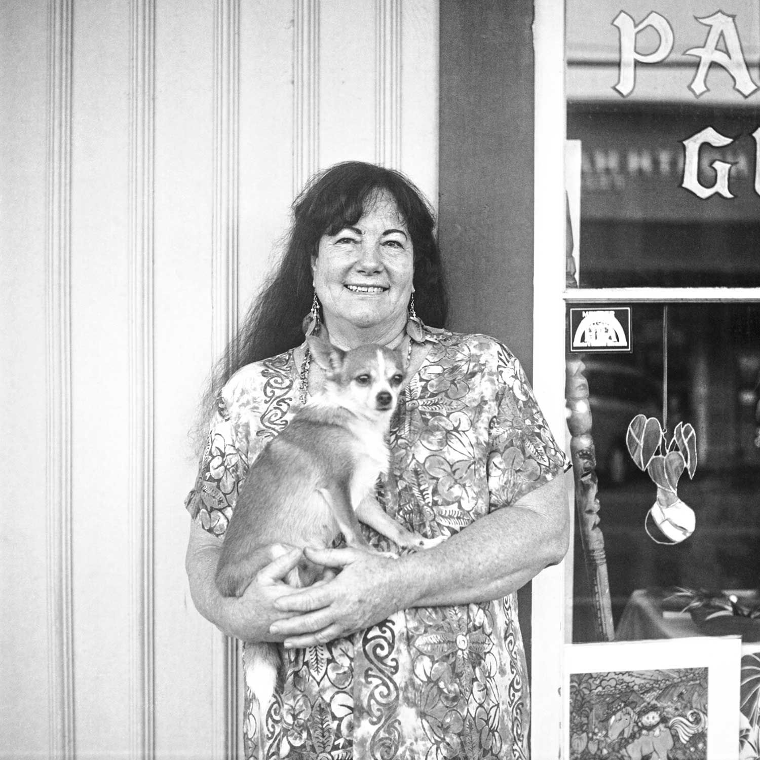 black and white photo of Edie Bilke holding a little dog in her arms