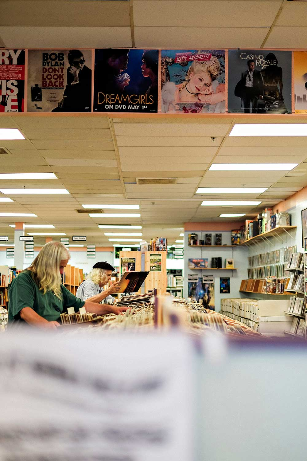 people looking at records in a record store