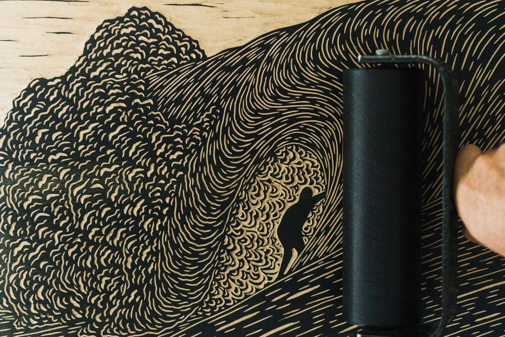 Woodblock printing of waves and surfer