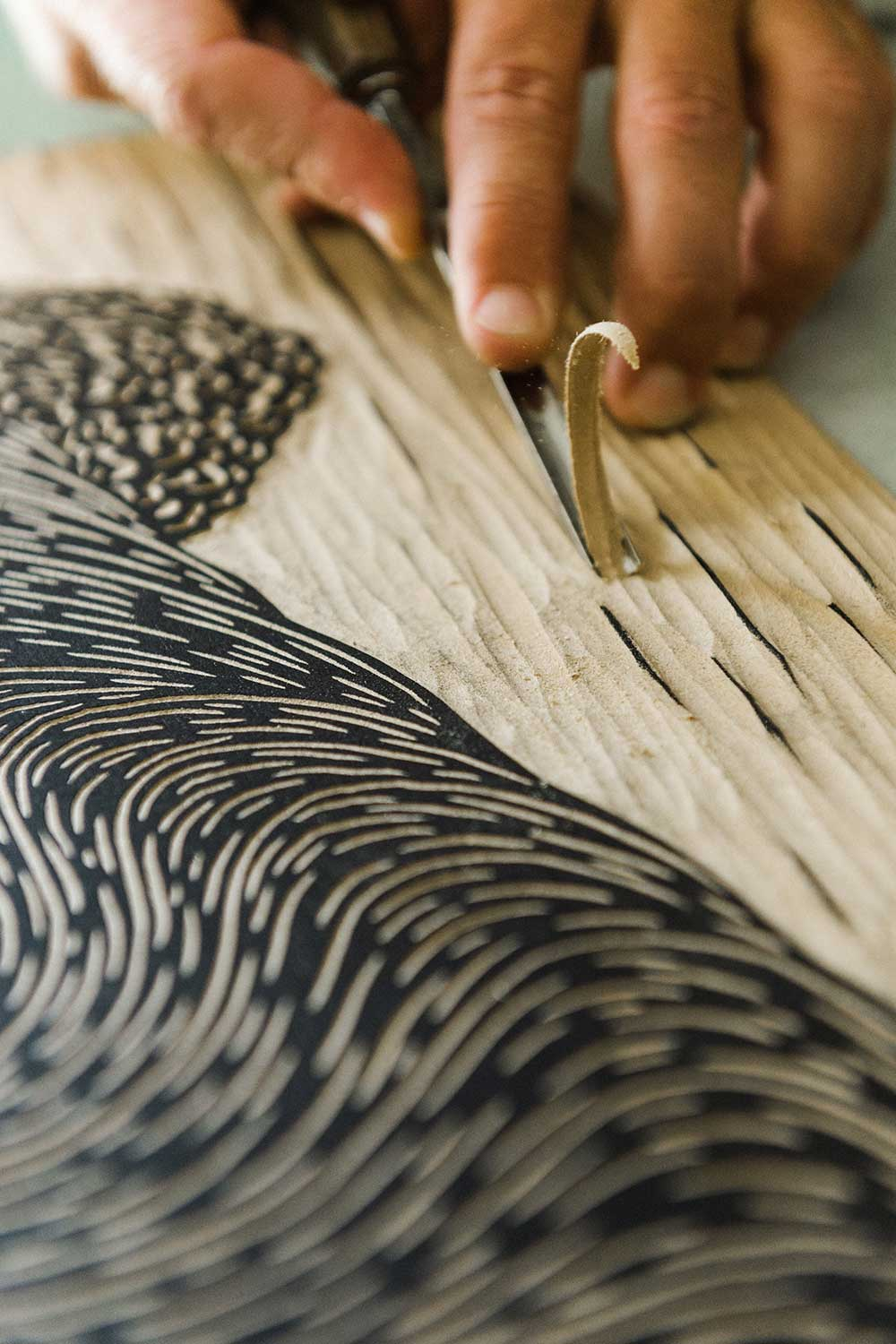 Close up of Steven Kean's hand make a woodcut