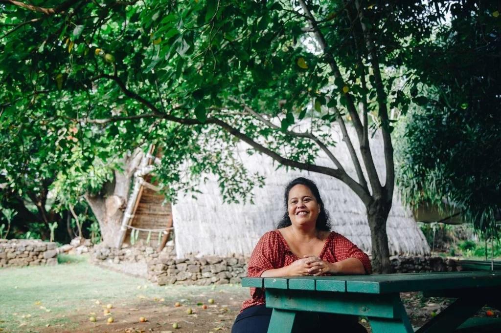 Malia Nobrega-Olivera sitting on a table