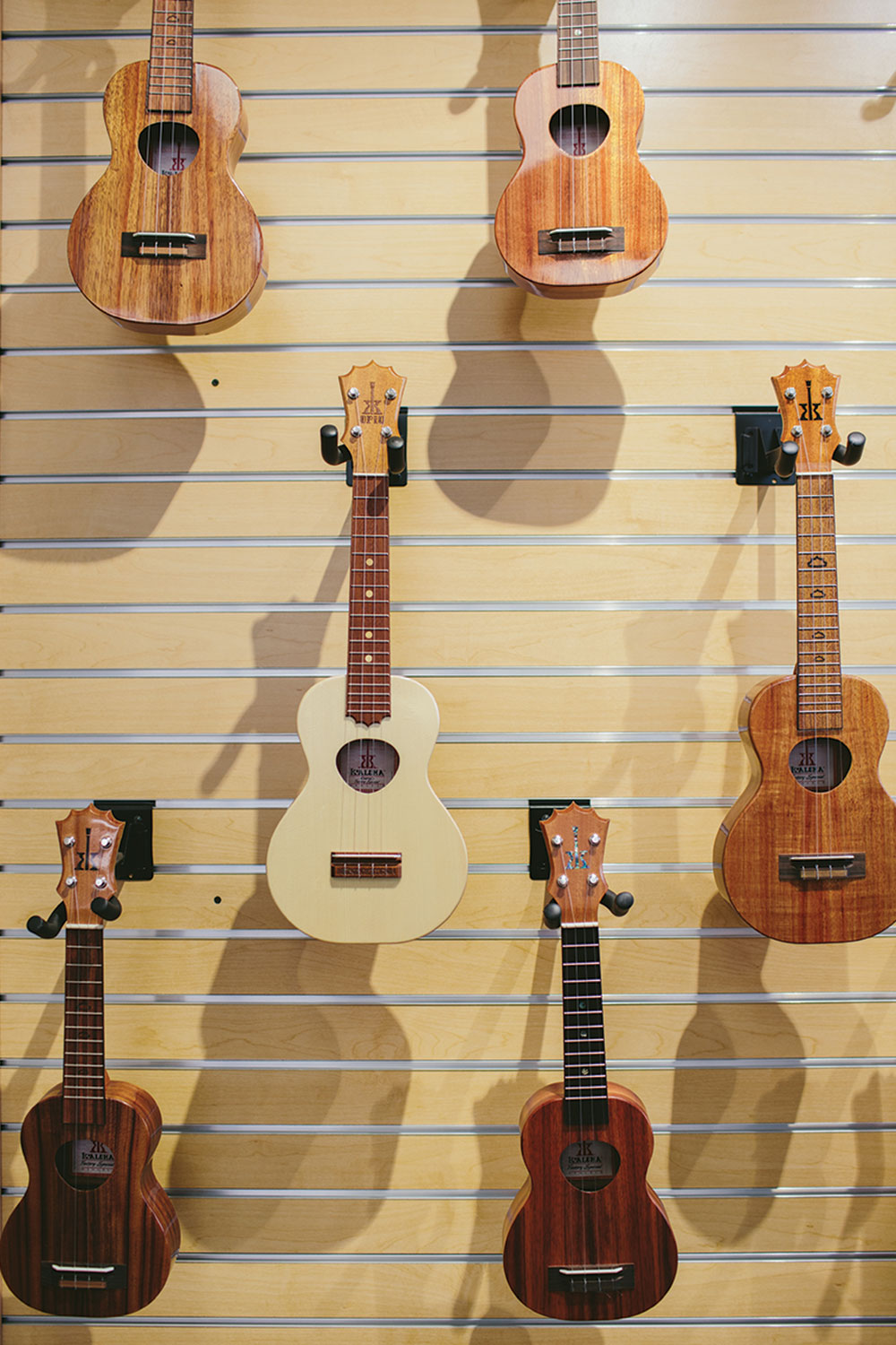 Various brown colored ukulele's