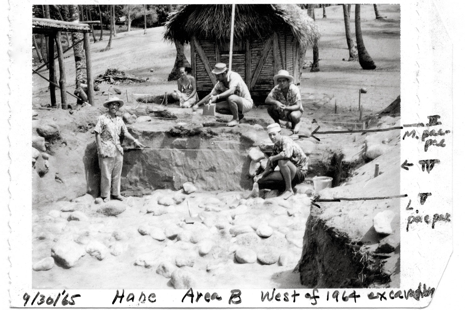 Black and white photo of men at an excavation site. Hand written text overlays image.