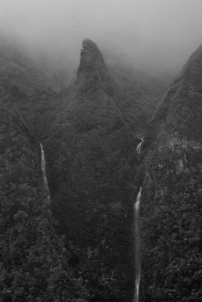 Black and white image of two water falls on the Koolau mountain range