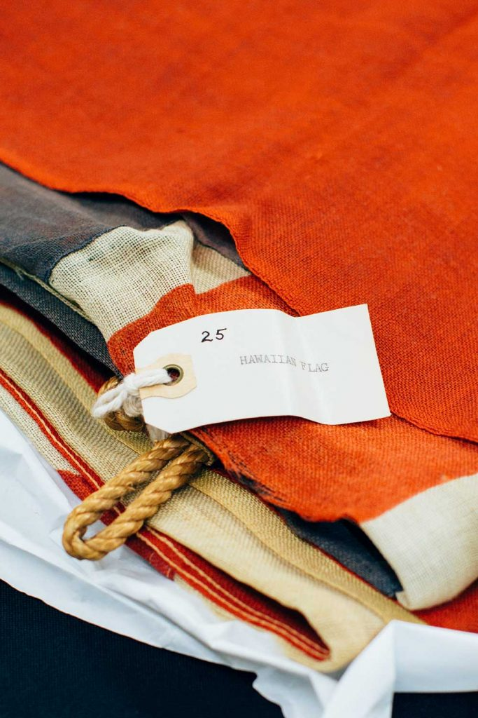 Close up of a stack of Hawaiian flags with a tag showing