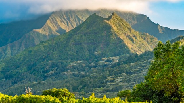 East view of Hīhīmanu mountain from Princeville with Nāmolokama in the background above Hanalei.