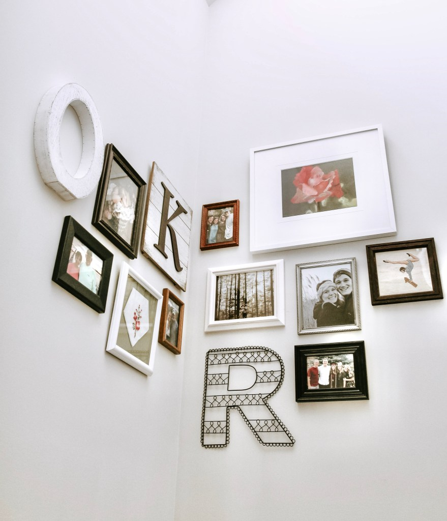 A photo of a wall with various framed photos. Example on how to personalize your home with photo collages