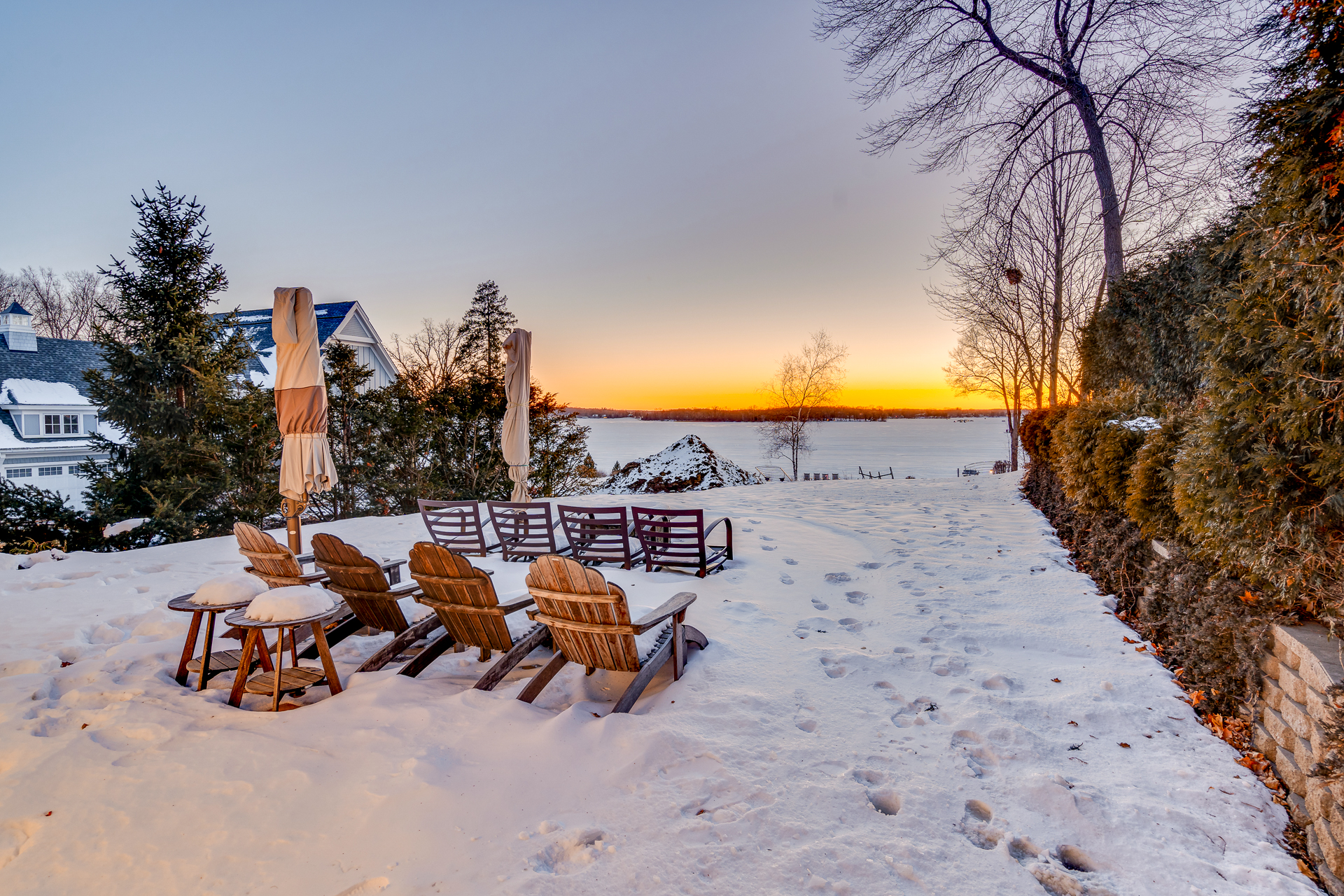Snowy backyard with view of Lake Minnetonka from Casco Point