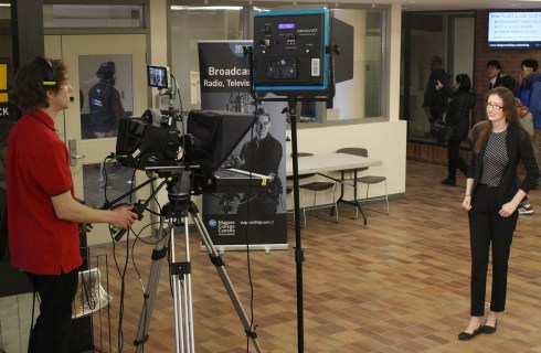 Taylor Snape, left films Taylor Judson as they run through a mock broadcast for a class assignment on March 17, 2017. PHOTO BY HALEY SEDGWICK