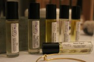 A selection of essential oil rollerballs sold by To the Moon and Back, Miranda Veide's health and wellness line.