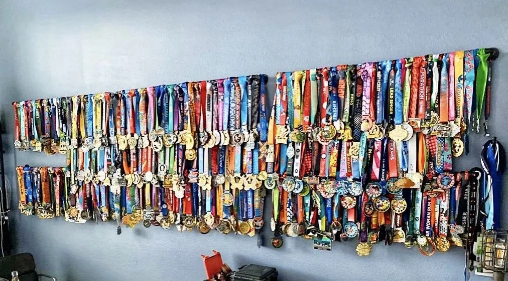 wall of running medals