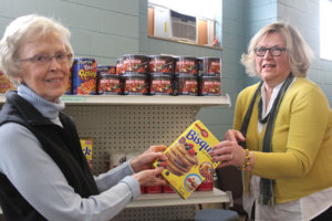 Tiffany Krupke/Albert Lea Tribune Dorothy Simonsen, left, and Betty Buffington help stock the Ecumenical Food Shelf.