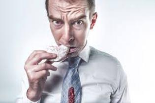 man eat doughnut