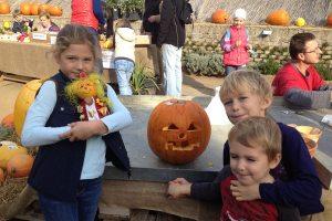 Anna, Samuel, and Oliver celebrating Halloween