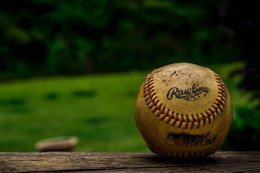 Macro view of baseball photo by Joey Kyber (@jtkyber1) on Unsplash