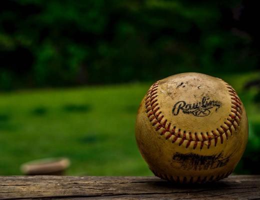 Macro view of baseball photo by Joey Kyber (@jtkyber1) on Unsplash