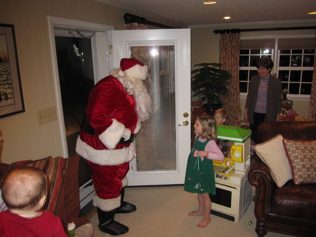 A surprised Anna greeting Santa Claus at my parents' backdoor