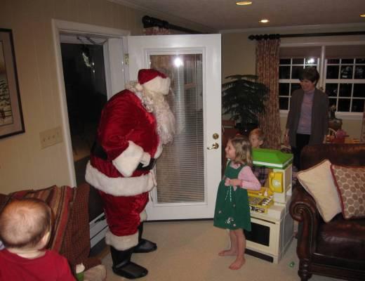 A surprised Anna greeting Santa Claus at my parents' backdoor