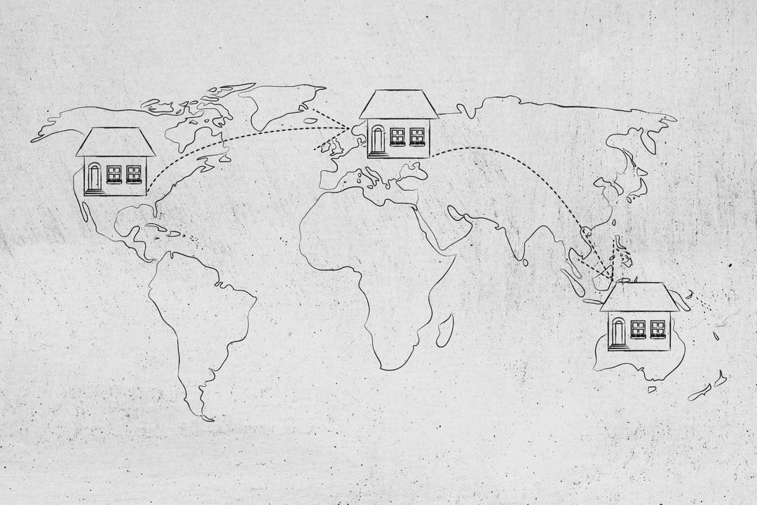 concet of moving to foreign countries and living as expat: house icon with arrows changing position on map of the world a few times