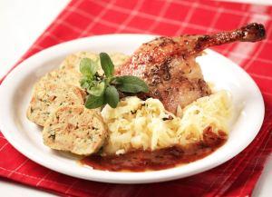duck, cabbage & dumplings on a plate