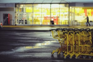 yellow grocery carts in front of lit store
