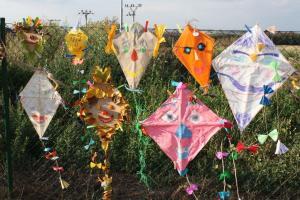 colourful kites hanging on preschool garden fence