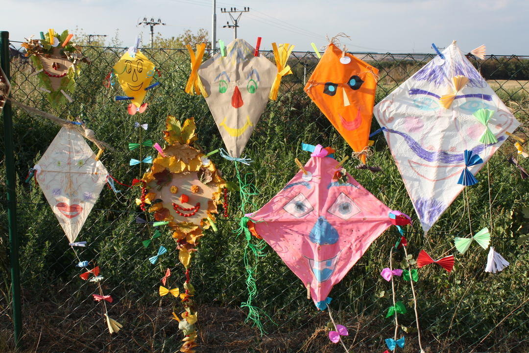 colourful kites hanging on preschool garden fence