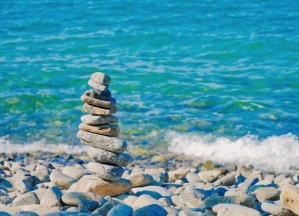 tower of smooth stones on a rocky beach