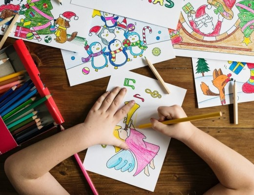 child colouring a colouring sheet