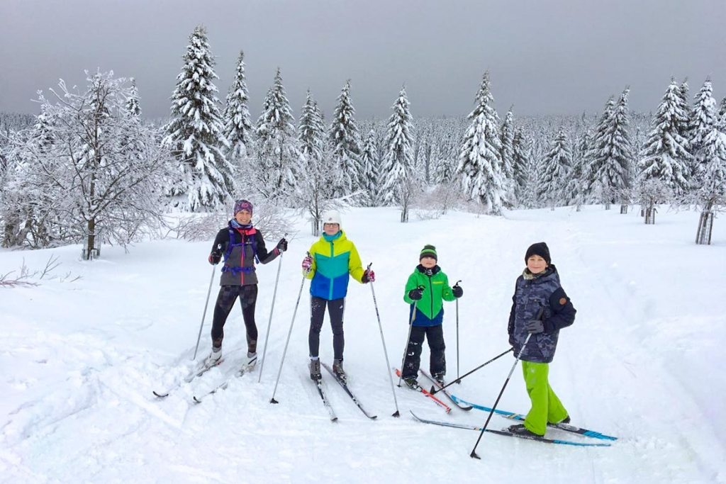 Emily with her children cross-country skiing