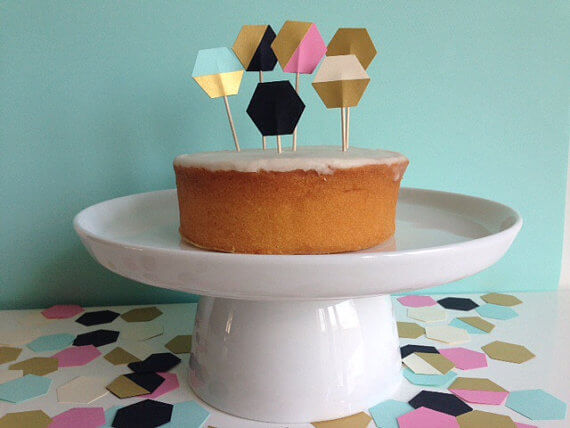"""Sick of overdone events? Stay classy with """"no theme"""" parties featuring pattern and color. Simplicity at its best with this naked cake and hexagon toppers. Pattern Party Trend 