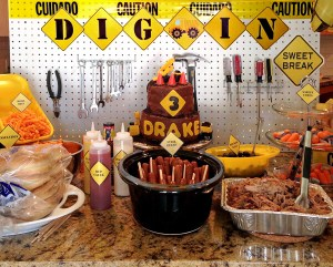 Construction 3rd birthday party blast | Halfpint Party - The food table was the focus inside. The tool display, construction cake, and all the fun food labels really made the party.