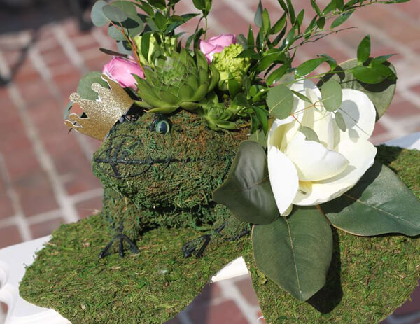 Princess and the Frog party. Greenery Inspired Parties   Halfpint Design - this frog centerpiece is so elegant. Frogs take on a feminine touch with this Princess and the Frog party