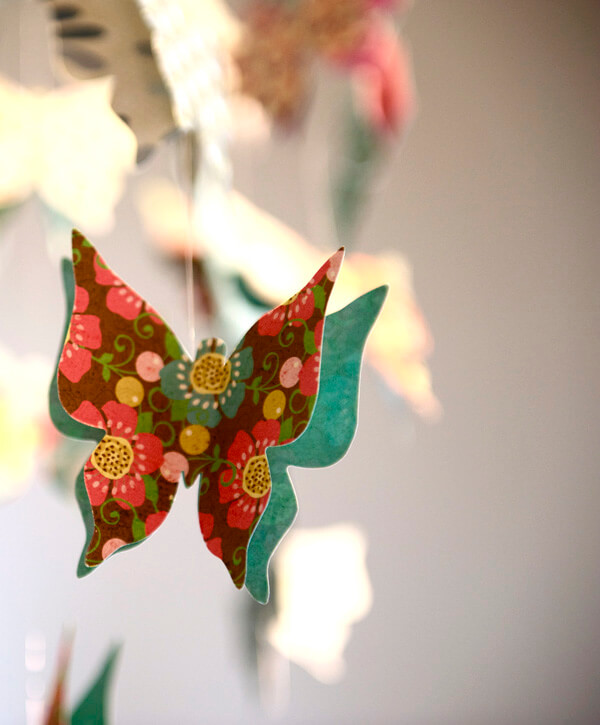 Butterfly First Birthday Party | Halfpint Design - Buffet butterfly chandelier close up.