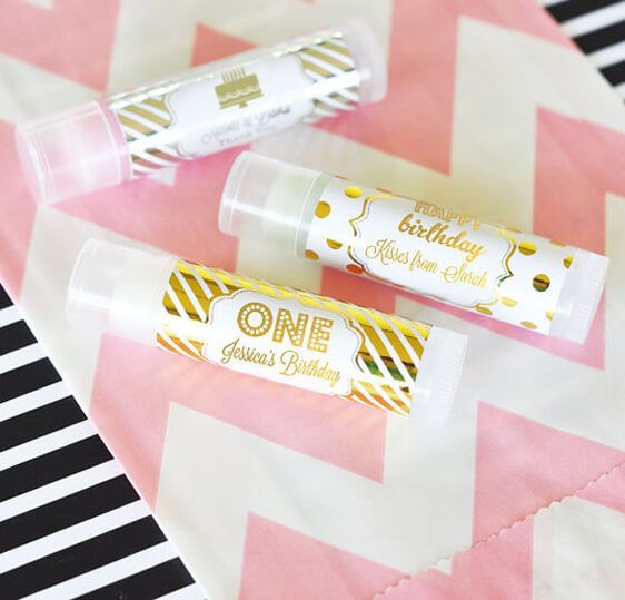 Planning Your First Children's Birthday Party | Halfpint Design - Great custom labeled chapstick favors for a first birthday that includes adult family and friends