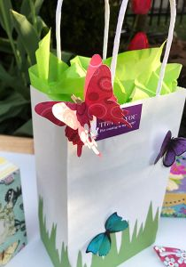 DIY Butterfly Party Favor | Halfpint Design - Cute little favor bag, use a small craft bag filled with treats, or this larger bag as a party loot bag or a gift bag for the birthday girl. Close up of the butterfly cut with my Silhouette, file in post.