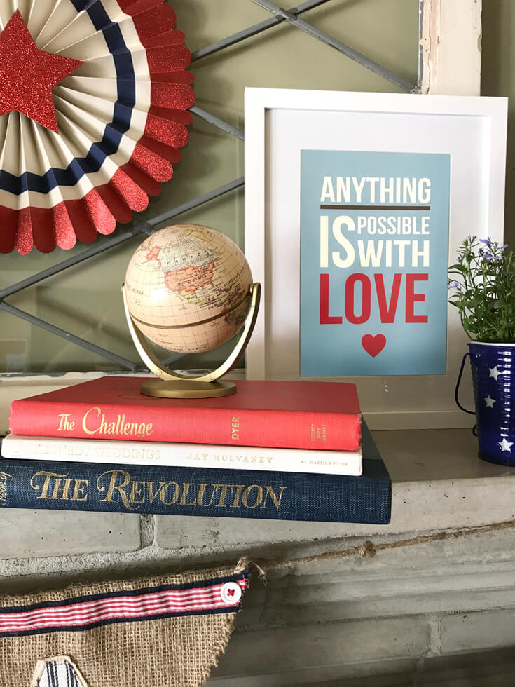 Patriotic Mantel Decor Ideas | Halfpint Design - Loving the more rustic Americana decor for my fourth of July Mantel. Mini globe shows the Americas, atop a stack of red, white, and blue books. 4th of July Decor.