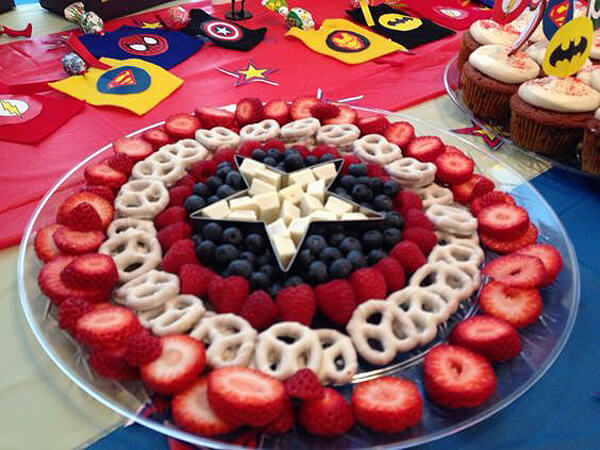 Fruit and cheese for Captain America's shield?! Yes please. Works equally as well for a Wonder Woman. Wonder Woman Party Food | Halfpint Design, party ideas, party themes