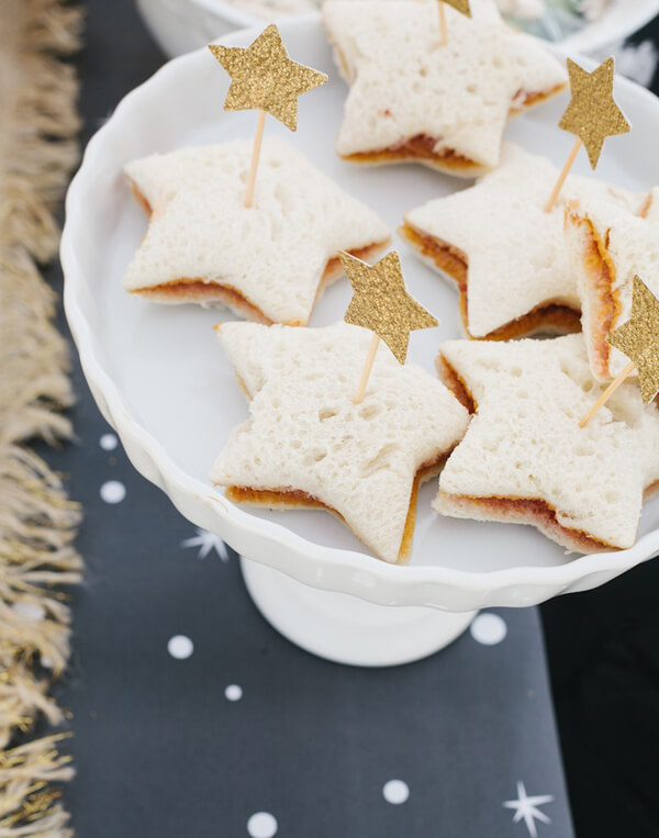 Star shaped sandwiches give a little nutrition during a birthday party. Wonder Woman Party Food | Halfpint Design, party ideas, party themes