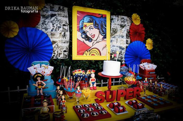 This comic inspired party backdrop is fantastic with the printed pages and iconic Wonder Woman focal point. Comic Wonder Woman Party | Halfpint Design, party ideas, party themes