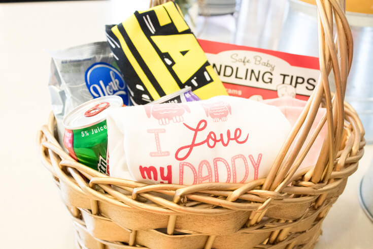 """Don't forget about Daddy. A basket filled with fun stuff: """"Luke, I am you Father"""" t-shirt, Baby Care Guide Book for Dads, candy, energy drink, and of course an """"I love my daddy"""" onesie! - Sweet Little Peach Baby Shower 