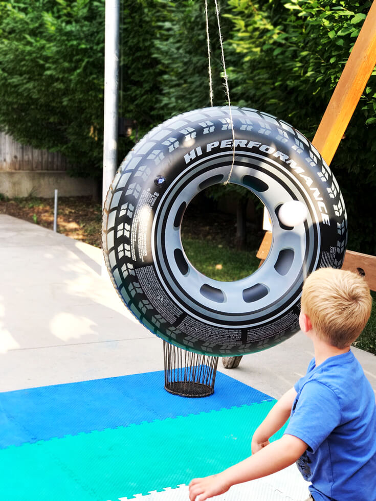 """The """"Hole Shot"""" activity was a tough one for the 5 year old crowd. Toss a ball through the open hole of huge inflatable tires. For older kids have the tires spin slowly for an added challenge. Monster truck party activity ideas 