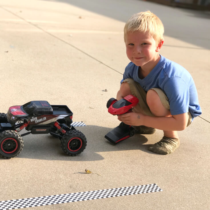 Monster Truck bowling! Driving a remote controlled monster truck into the pins was great fun!! Monster truck party activity ideas | Halfpint Design - boy party theme
