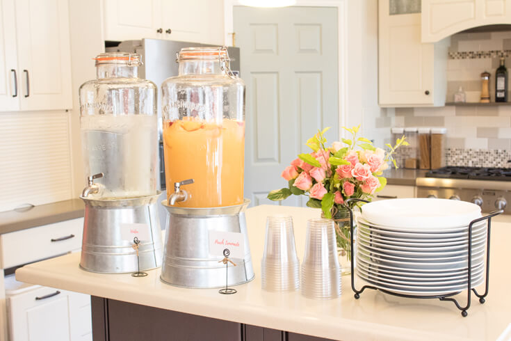 Beautiful Drink dispensers with water and peach lemonade {of course!} A nice drink dispenser is a must have event items that you should probably invest in. - Sweet Little Peach Baby Shower | Halfpint Design