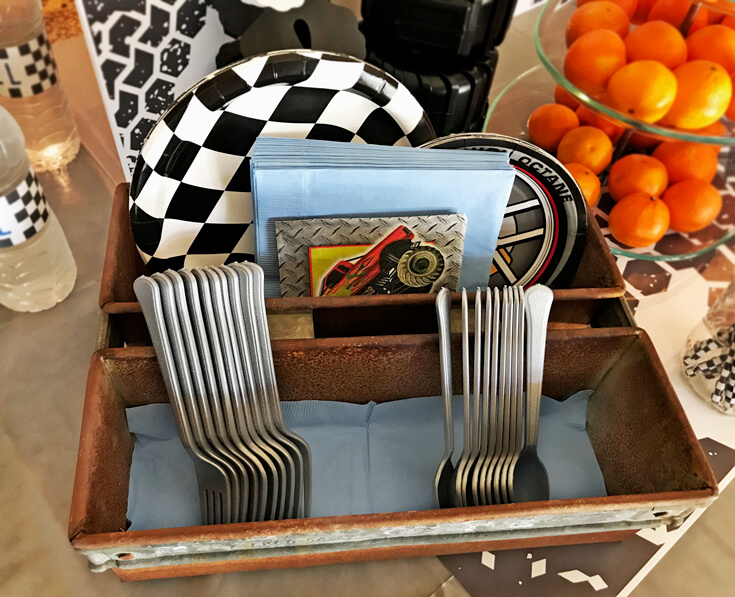 Extra plates and utensils for the adults displayed in a rusty old toolbox. Monster Truck Menu | Halfpint Design - party food, event menu