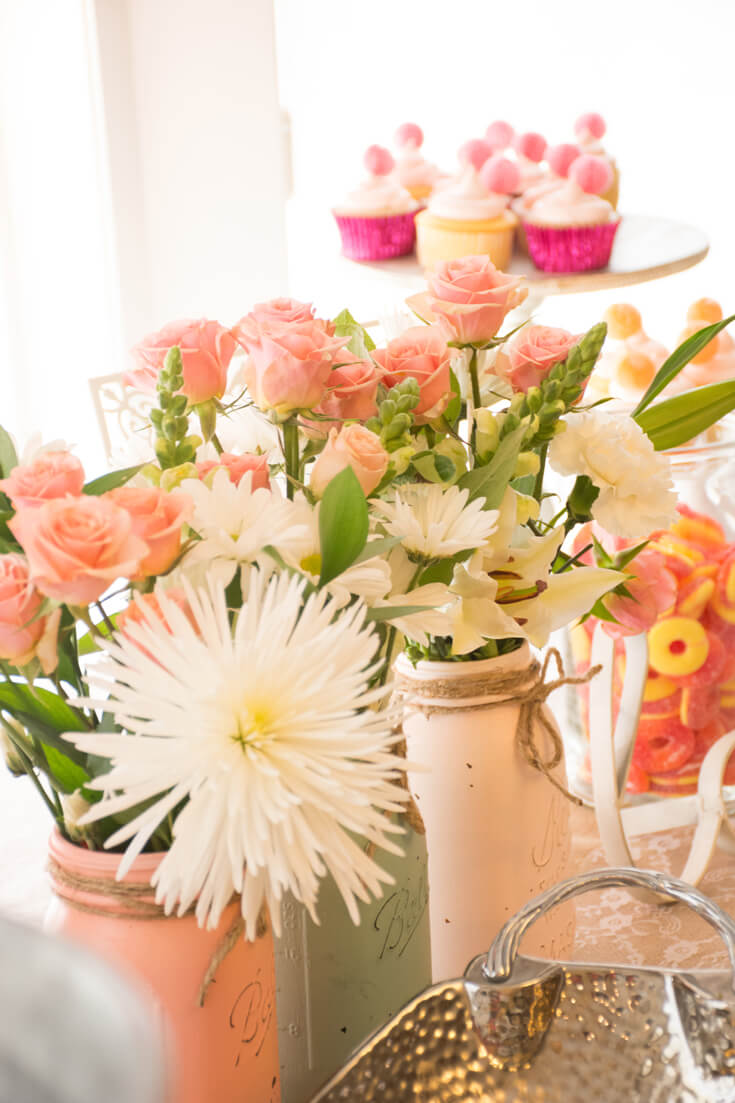 Baby shower centerpieces son't have to be expensive. For affordable centerpieces use painted Mason jars filled with fresh flowers. Costco and other grocery floral departments have surprisingly great selection at even better prices. My absolute flower fave??? Trader Joes! - Sweet Little Peach Baby Shower | Halfpint Design