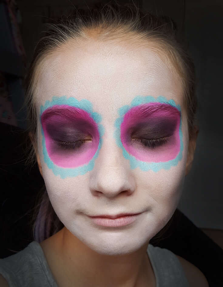 If you've ever wondered how to do cool sugar skull makeup for a day of the dead or Halloween party this tutorial is for YOU! SUPER easy, anyone can do it. Step 2 is to add color around the eyes. Sweet Sugar Skull Makeup Tutorial | Halfpint Design - party makeup, costume makeup, dia de los muertos