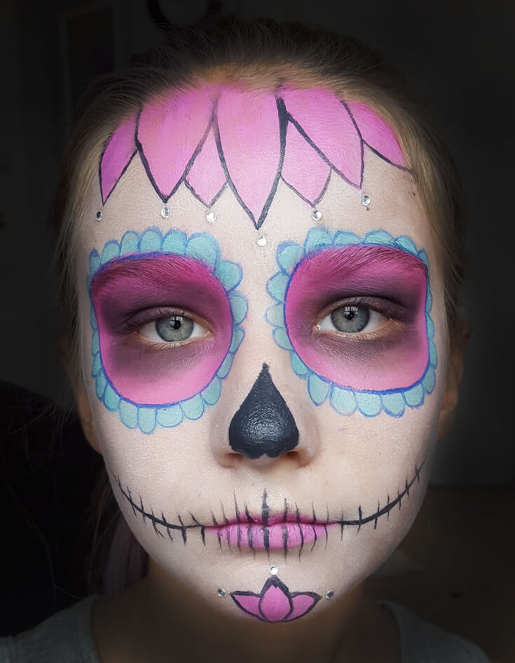 If you've ever wondered how to do cool sugar skull makeup for a day of the dead or Halloween party this tutorial is for YOU! SUPER easy, anyone can do it. Step 4 is the finishing touch. Add hot pink lipstick. Create a skull mouth and nose. Sweet Sugar Skull Makeup Tutorial | Halfpint Design - party makeup, costume makeup, dia de los muertos