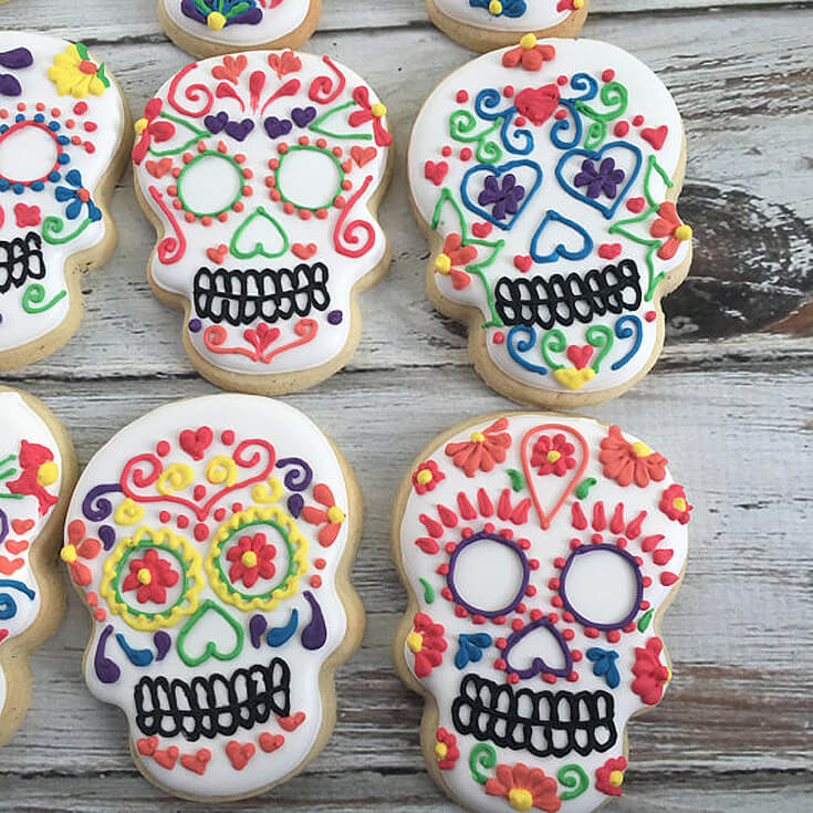 These sugar skull cookies are amazing for a Day of the Dead party. Dia de los Muertos Party Resources   Halfpint Design - Halloween party, party decorations, party clothes