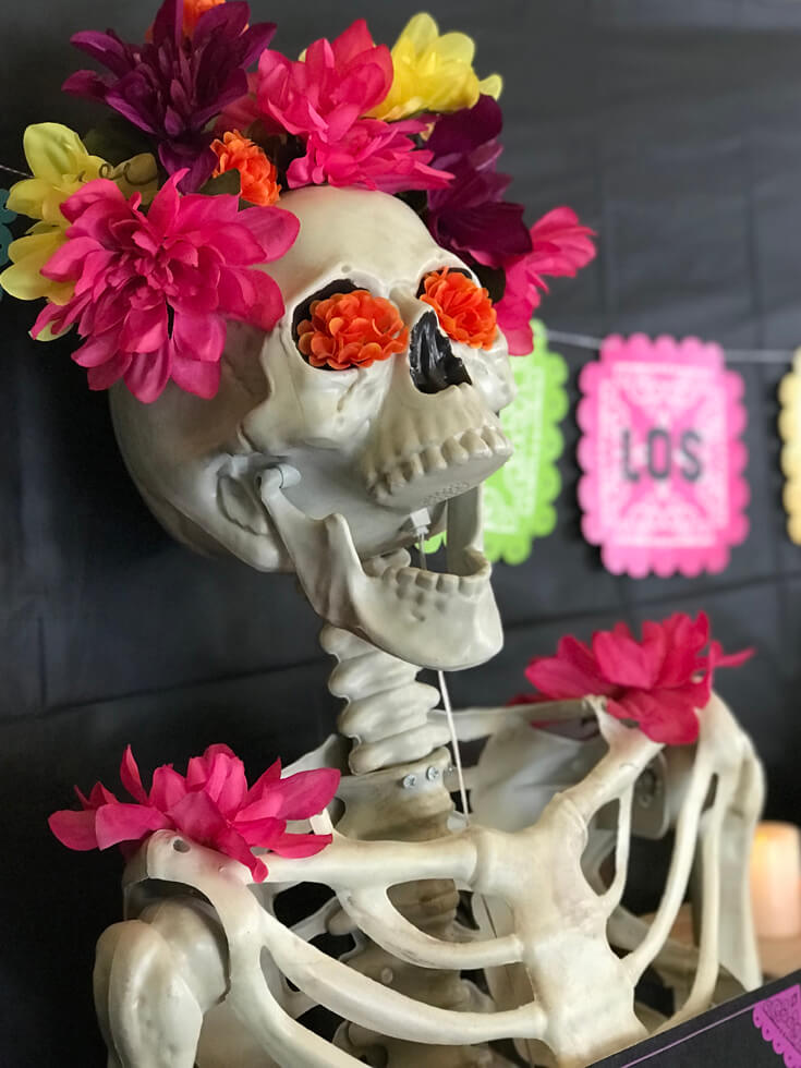 Skeletons get a face lift for the Day of the Dead! Add flowers to your Halloween decor for bright and cheery part guests. Coco Viewing Party Tips at Halfpint Design. Day of the Dead Party, Dia de los Muertos, Coco birthday party